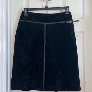 Margaret Godfrey, black suede skirt. 8